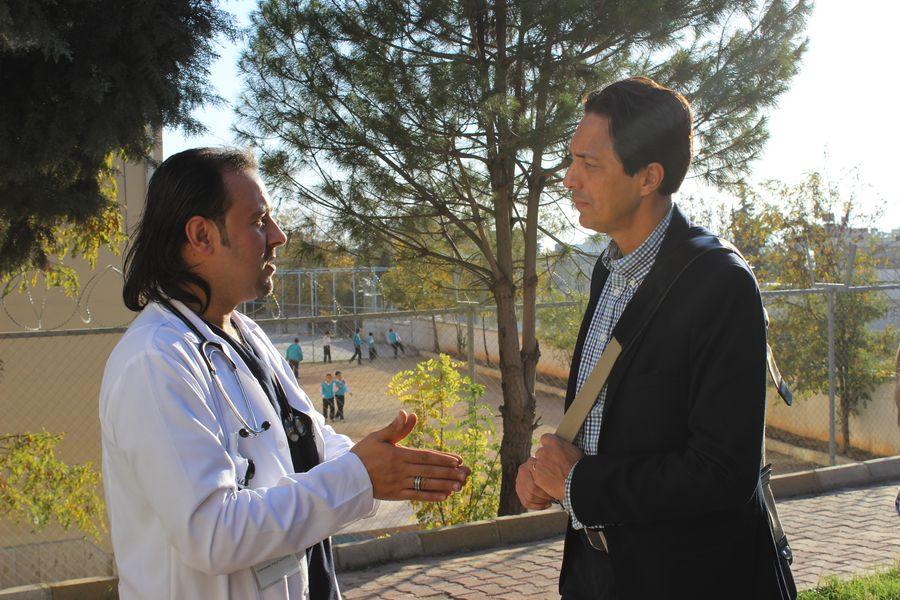 Sid Johann Peruvemba (right), in conversation with a doctor at the Malteser International field hospital in Kilis, Turkey.