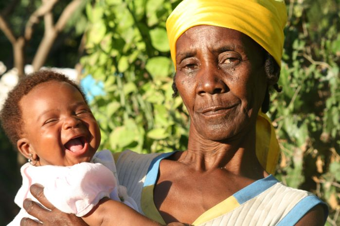 This woman and her granddaughter are happy with the latrine that was built in their home.