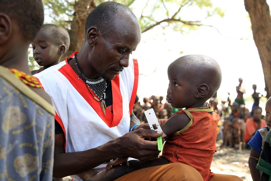 A child doing the MUAC test in Kenya