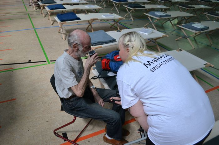 Providing care at an emergency shelter.