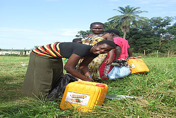 Women that now have the food to provide for their family, and the proper tools to harvest for their future.