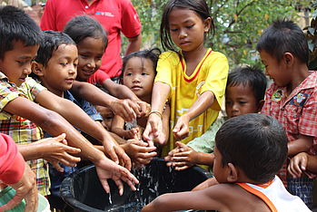 Before lunch, the children rushed to the water pit to wash their hands.