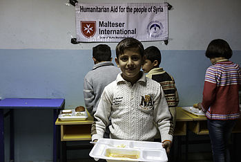 Malteser International is supporting a school for Syrian children, and providing them with a warm meal every day. Photo: Kerem Yucel