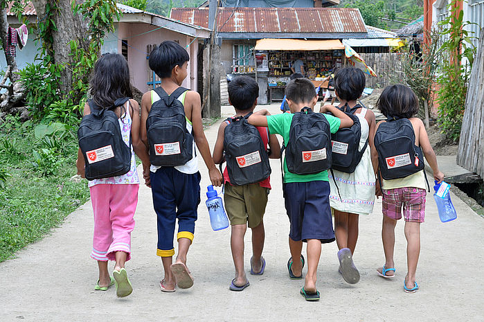 Time to move on after the typhoon: these kids are happy to be able to go back to school. Photo: Kenly Monteagudo