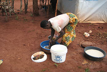 A woman washes clothes in the Mtendele refugee camp in north western Tanzania. Photo: Malteser International