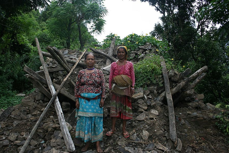Latima and her sister in the ruins of their old home.