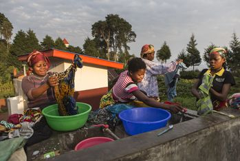 In the early morning, a group of women wash their clothes in the newly built facilities. Photo: Jana Asenbrennerova